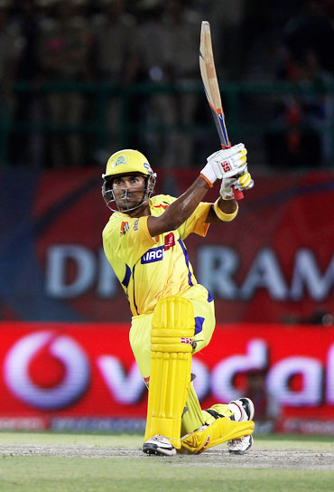 S Badrinath plays a lofted shot