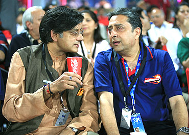 Sashi Tharoor with Amit Mathur of GMR Sports