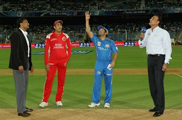 Match referee Javagal Srinath and Ravi Shastri watch Tendulkar and Kumble at the toss