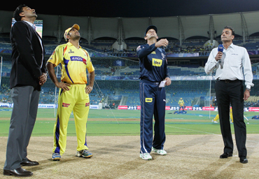 Adam Gilchrist of the Chargers tosses the coin with MS Dhoni of the Super Kings looking on ahead of the 2010 DLF Indian Premier League T20 semi final match