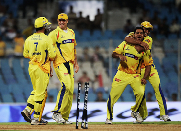 Shadab Jakati of the Super Kings celebrates with team mates the wicket of Mohnish Mishra