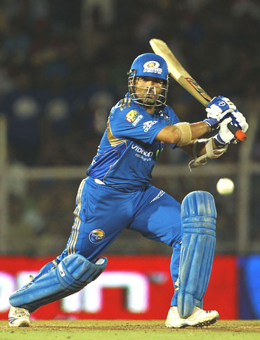 Tendulkar plays a shot against the Royal Challengers Bangalore in the IPL