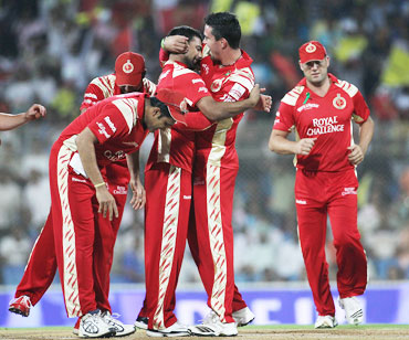 Praveen Kumar celebrates with team-mates