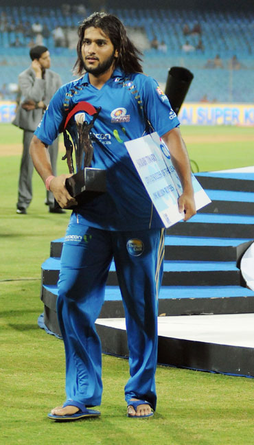 Saurabh Tiwary with the trophy