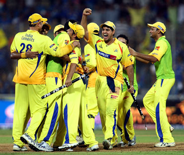 Chennai Super Kings players celebrate after winning the match
