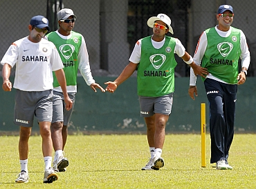 Indian team players walk back after a practice session