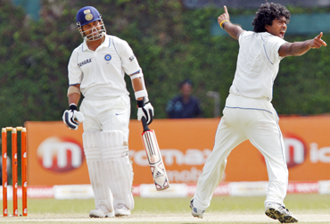 Sri Lanka's Lasith Malinga (right) successfully appeals for the wicket of India's Sachin Tendulkar