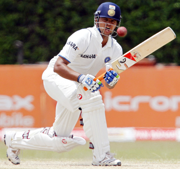India's Suresh Raina plays a shot during the third day of their third and final test cricket match against Sri Lanka in Colombo