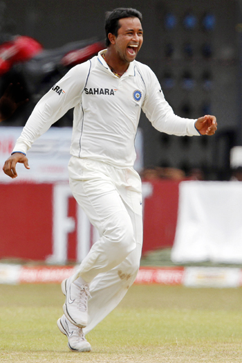 India's Pragyan Ojha celebrates taking the wicket of Sri Lanka's captain Kumar Sangakkara