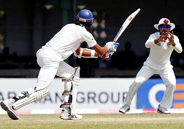 Kumar Sangakkara (right) takes a catch to dismiss Ishant Sharma