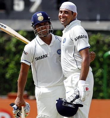 VVS Laxman (right) celebrates with Suresh Raina