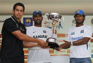 Ross Taylor, MS Dhoni and K Sangakkara with the Micromax trophy