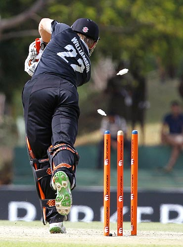 Kane Williamson is bowled by Praveen Kumar