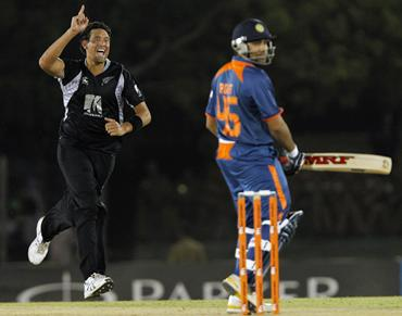 Daryl Tuffey celebrates taking the wicket of Rohit Sharma