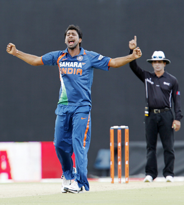 India's Praveen Kumar celebrates taking a wicket against Sri Lanka