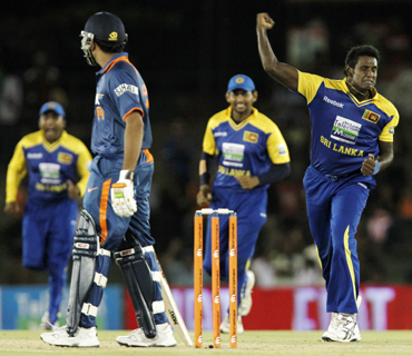 Sri Lanka's Angelo Mathews (right) celebrates taking the wicket of India's Rohit Sharma
