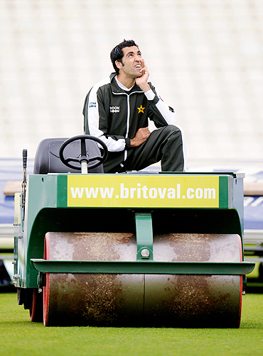 Umar Gul gazes into the sky while his teammates attend a training session
