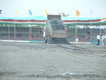 A truck-load of gravel is emptied on the Madhavrao Scindia Cricket Ground