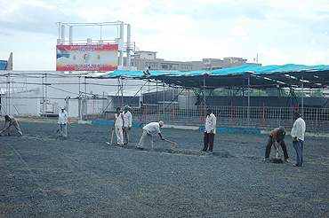 A group of labourers go about their job at the Madhavrao Scindia Cricket Ground