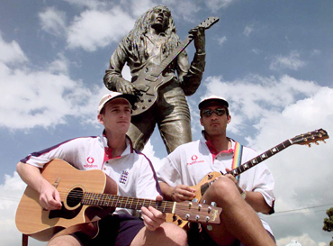 England cricketers John Crawley and Mark Butcher (right) play their guitars in front of Bob Marley