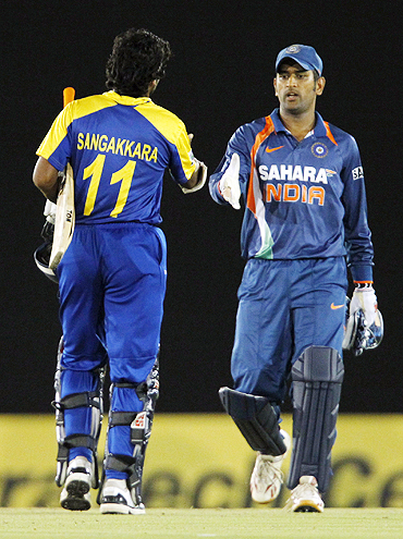 Mahendra Singh Dhoni congratulates Kumar Sangakkara after Sri Lanka's win on Sunday