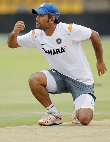 Mahendra Singh Dhoni examines the pitch for Wednesday's clash against New Zealand