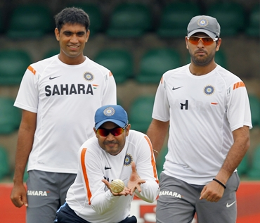 Virender Sehwag (centre), Munaf Patel (left) and Yuvraj Singh go through a catching practice session