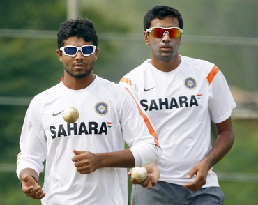 Ravindra Jadeja (left) and R Ashwin await their turn to bowl in the nets