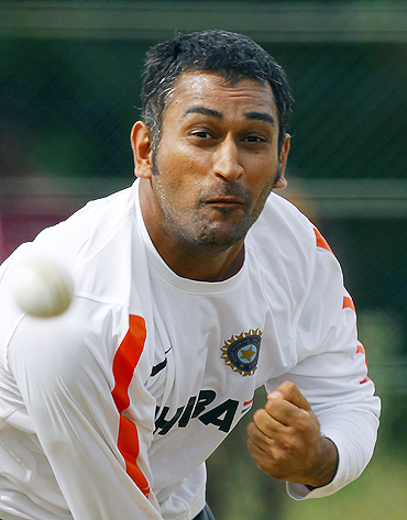 Indian skipper Mahendra Singh Dhoni bowls in the nets during a practice session on Monday