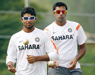 India's Ravindra Jadeja (left) and R Ashwin await their turn to bowl during a practice session on Monday