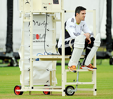 England's Kevin Pietersen sits on a bowling machine during a training session at Lord's cricket ground in London on Wednesday