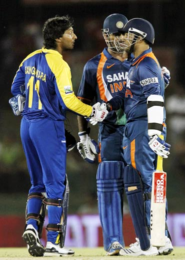 Virender Sehwag (right) chats to Kumar Sangakkara as Mahendra Singh Dhoni looks on
