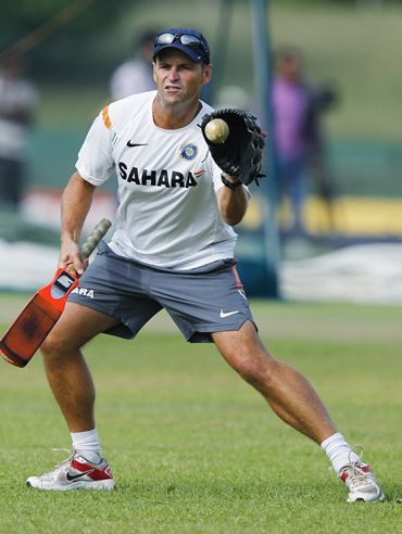 India coach Gary Kirsten catches a ball with a baseball glove as he runs through drills