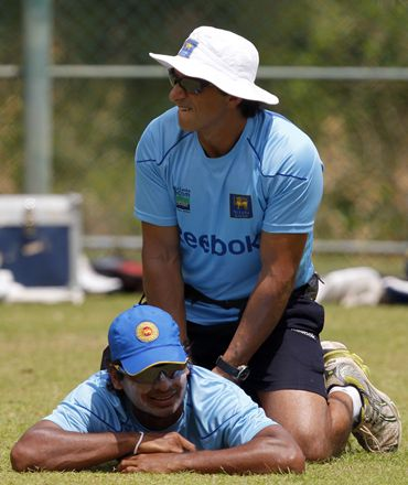 Sri Lanka's captain Sangakkara is treated by team physiotherapist Clark during a practice session