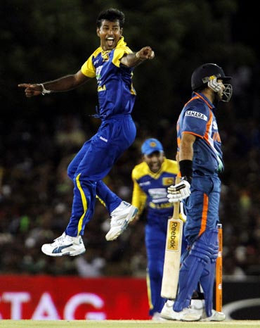 Nuwan Kulasekara (left) unsuccessfully appeals for the wicket of Yuvraj Singh