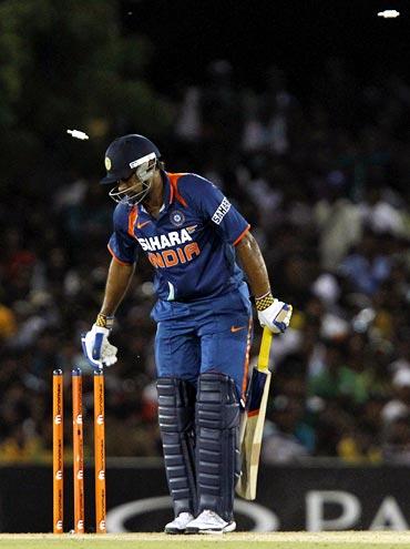 Praveen Kumar is bowled by Lasith Malinga