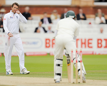 England's Graeme Swann (left) looks on after bowling Pakistan's Azhar Ali on the fourth day of the fourth Test on Sunday