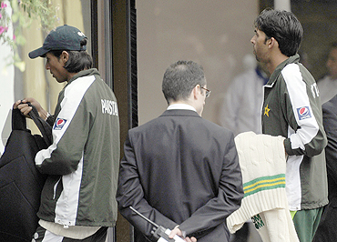 Pakistan cricketers Mohd Aamir (left) and Mohd Asif arrive at the team hotel after their team's defeat against England on Sunday