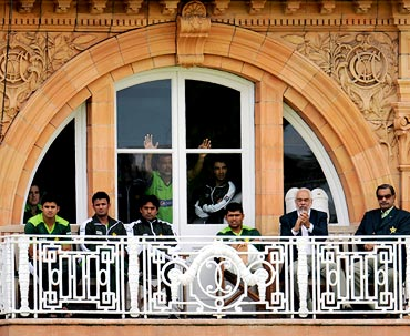 Pakistan cricket team watch from the dressing room during day four of the fourth Test against England at Lord's on Sunday.