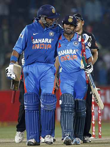 Yuvraj Singh and Gautam Gambhir celebrate after winning the second ODI against New Zealand in Jaipur