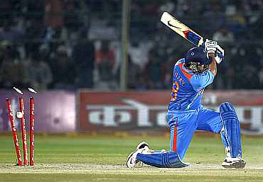 Murali Vijay is clean bowled by Daniel Vettori during the second ODI against New Zealand