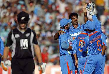 Munaf Patel celebrates with team-mates after picking up the wicket of Kane Williamson during the second ODI in Jaipur