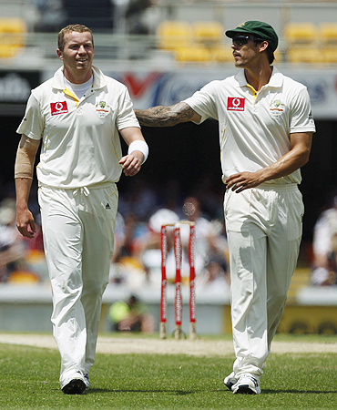 Australian bowlers Peter Siddle (left) and Mitchell Johnson