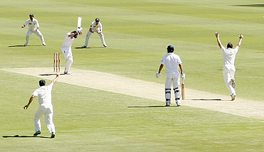 England's Andrew Strauss is bowled by Australia's Doug Bollinger (right) on Saturday