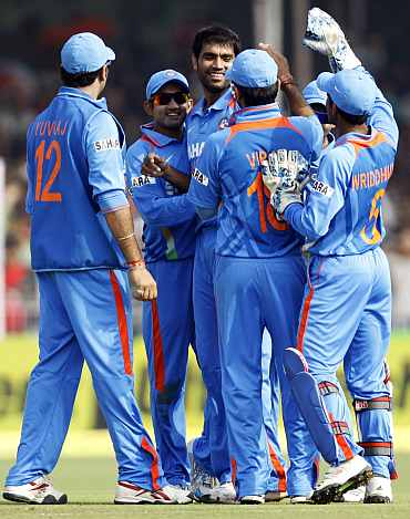Indian players celebrate after picking up a wicket against New Zealand