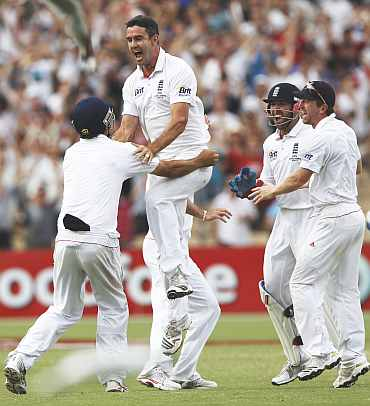 Kevin Pietersen celebrates after picking up Michael Clarke during the second Ashes Test in Adelaide