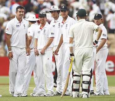 England players wait for the umpire's decision during the second Ashes Test in Adelaide