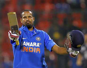 Yusuf Pathan celebrates after making a century against New Zealand in Bangalore