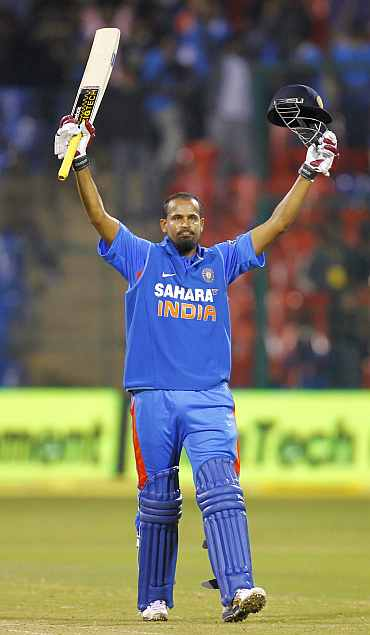 Yusuf Pathan reacts after hitting a century against New Zealand in Bangalore