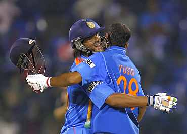 Saurabh Tiwary and Yusuf Pathan celebrate after winning the match against New Zealand in Bangalore